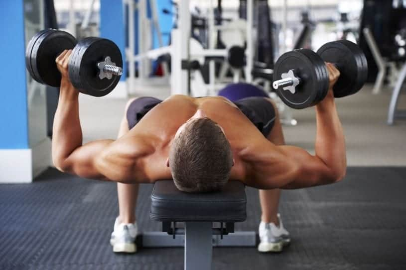 athlete doing chest press