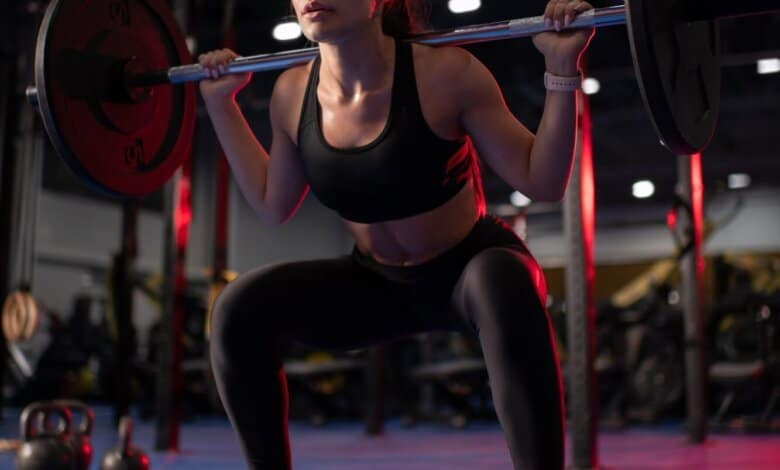 Female athlete squatting with barbell